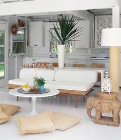 Tropical Living-Dining Space    Wicker, raffia and rattan accents offer texture and a casual, beachy note.      Mix playful, rough & unexpected objects - White painted cabinet lattice. - Designer: Michelle Lloyd Bermann, Lloyd Ralphs Design -- Modern Cottages | House & Home July 2007