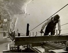 Construction workers on the Golden Gate Bridge, San Francisco, between 1935 and 1937. Construction of the Golden Gate Bridge began with the digging of a pit for the Marin County anchorage on January 5, 1933.