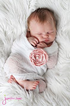 I love the flower attached to the swaddle.