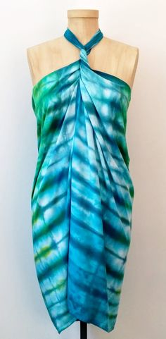 I was in my studio dreaming about the sea...the gorgeous blues and greens, cool drink in my hand, wrapped in this cute sarong!  This piece was hand dyed with a Japanese itajime shibori technique and fiber reactive dye.  It can be worn in a multitude of ways!  For more go to www.flygurldesigns.etsy.com.