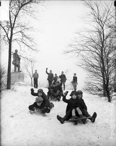 """""""Children sledding, Chicago, Illinois, 1929."""" / Photograph by the Chicago Daily News at the Chicago History Museum"""