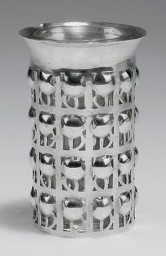 Josef Hoffmann. Pierced Vase, c. 1909, H. 8.7 cm. Made by Wiener Werkstätte. Silver, open pattern. Marked: Diana's head (hexagon), WW, JH, Rose mark, AB in a circle. Engraved inscription: Joachim. Clear glass inset. | To be auctioned Dec. 8, 2015, estimate 6,000 - 8,000 €