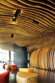 Innovative, award-winning design—the Genexis Theater, Fusionopolis in Singapore used 400,000 timber beads that line the internally curved walls of an ovoid space, reducing the echo to a minimum. Designed by ARUP/WOHA architects, photos (this one of the front of house) by Patrick Bingham-Hall