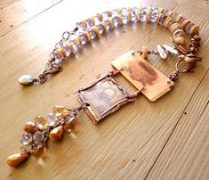 Jewelry by Nina Bagley...is that antique mop buttons alternating w/ the beads? If so, love it