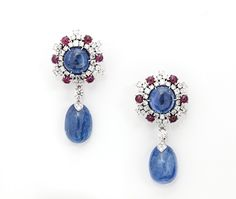 A PAIR OF SAPPHIRE, RUBY AND DIAMOND EAR PENDANTS, by BULGARI Set with 4 cabochon Burmese sapphires weighing a total of approximately 100 carats, the tops pavé-set with cabochon rubies weighing a total of approximately 2 carats and diamonds weighing a total of approximately 5 carats.