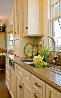 Love these creamy kitchen cabinets and the double hung window over the sink