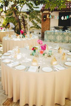 If you are having an outdoor wedding don't compete with the colors in nature instead choose neutrals with small pops of color   and let the natural backdrop shine