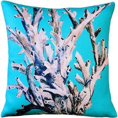 The ivory bush coral depicted on this pillow is set against a dazzling turquoise background that highlights its intricate and delicate structure.