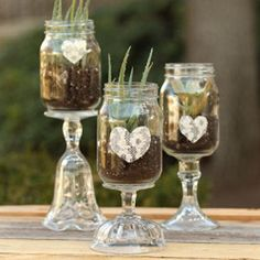 Whether you're planning a wedding or just looking for some unique Mason jar projects to display in your home, these 17 Easy Crafts with Mason Jars are a great way to create budget-friendly decorations. Mason Jar Vases, Mason Jar Centerpieces, Mason Jar Wine Glass, Mason Jar Diy, Centerpiece Ideas, Wedding Centerpieces, Quinceanera Centerpieces, Wedding Decorations, Upcycled Crafts