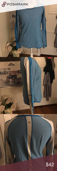 Lululemon thermal workout top Adorable white and blue striped thermal Lululemon long sleeve top. Thumb holes make a great addition to this perfect workout shirt! Worn once. Great condition! lululemon athletica Tops Tees - Long Sleeve