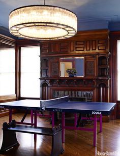 Do you see the brilliance? Or does a ping pong table not belong in the formal space? Tell us below!