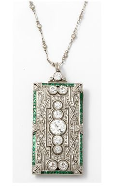 An Art Deco platinum emerald diamond brooche/pendant