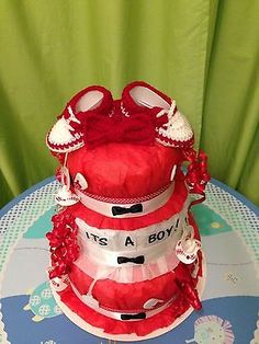 It's a Boy! Diaper Cake. This red and white diaper cake accented with little black bow ties will make a great baby shower gift or gift for the parent/parents to be. www.heavensentcreations.net