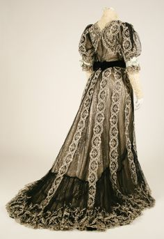 Dress, back view.  House of Worth (French, 1858–1956).  Date: 1906.  Culture: French.  Medium: silk, cotton.  Dimensions: (a) Length at CB: 18 in. (45.7 cm). (b) Length at CB: 52 in. (132.1 cm).