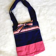 Preppy Canvas Shoulder Tote Pink, navy, and topped with a grosgrain ribbon: prep status secure! This adorable accessory is longing for topsiders! Clean inside and out, excellent condition! Bags Totes