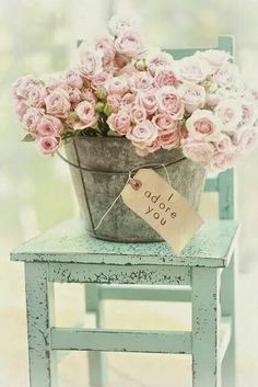 turquoise stool with bucket with pink roses
