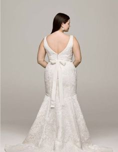 """<a href=""""http://www.davidsbridal.com/Product_all-over-lace-trumpet-gown-with-deep-v-neckline-8cwg621_wedding-dresses-plus-size-dresses"""" target=""""_blank"""">All Over Lace Trumpet Gown with Deep V Neckline</a>, David's Bridal"""
