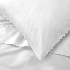 Combining decorative elegance with modern simplicity, the pretty pompom edge detail puts a playful spin on our classic bed linen. Made exclusively for us in Vietnam, from high-quality, cotton percale, Avignon Bed Linen feels wonderfull Brown Bed Linen, Neutral Bed Linen, Bed Linen Sets, Linen Duvet, Linen Pillows, Luxury Bedding Collections, Luxury Bedding Sets, Modern Bedding, Zara Home