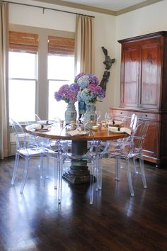 LOVE the acrylic chairs with the antique table and chest//Meg Lonergan