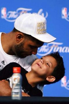 Spurs Tim Duncan his son. 2014 NBA CHAMPIONS