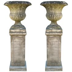 English Weathered Urns on Bases | From a unique collection of antique and modern urns at http://www.1stdibs.com/furniture/building-garden/urns/