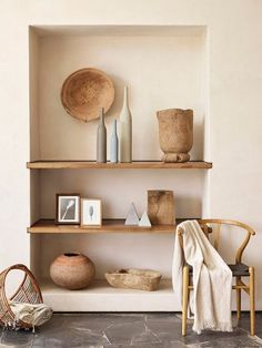 Minimal shelves and wishbone chair, creams, whites and natural tones