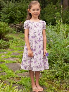 Cute as a button! The Lilac girls dress is made of delightfully soft Indian cotton and features a perfectly pretty floral print fit to match the sweet smiles your little one inspires. Self-fabric tie at the back creates a flexible fit that ensures an extended use.