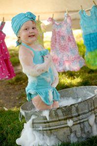 Fun idea for two year old girl photo shoot, metal bucket, galvanized tub, clothesline, swim cap