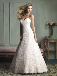 We love this classic lace gown!  Give it a repin.  Available at www.gatewaybridal.com