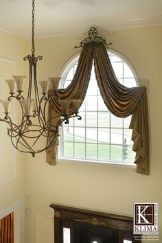 Arched Entry|Arched window treatments|Foyer light|Corbett Lighting
