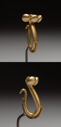An ancient Greek solid gold dress fastener, dating to the 6th Century B.C.