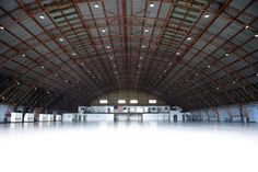 The venue is an enormous airplane hangar at the Santa Monica Airport, an air strip serving private jet owners from Southern California.  The interior and exterior space total more than 97,000 square feet, and the Hangar's location offers easy access to and from the most affluent communities of the region.
