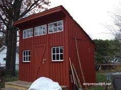 Tall shed with sloped roof and upper windows   Gallery of Garden Sheds