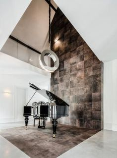 anything more classic than a baby grand? Here in a super slick modern setting