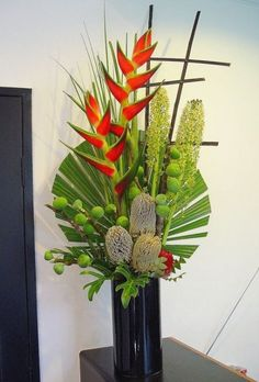 Tripical arrangement - crabclaws, banksias, pineapple lillies, figs , xanadu leaves and heart palm ~ latecia Tropical Flowers, Tropical Flower Arrangements, Church Flower Arrangements, Flower Centerpieces, Flower Decorations, Cactus Flower, Tropical Centerpieces, Creative Flower Arrangements, Altar Flowers