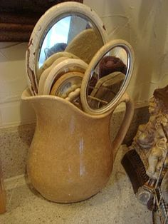 Dream in Cream - great way to display old hand mirrors