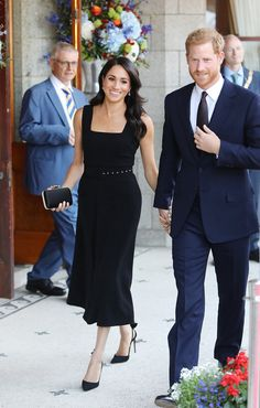 Meghan looked radiant in a chic black dress by British designer Emilia Wickstead as she attended a garden party with Harry
