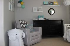 This nursery's shades of gray are super cool with yellow & turquoise accents.