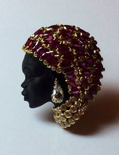 Blackamoor broche pave set rubies Diamond cut briolette and Diamond cut brillant set on 18cts signée Demner