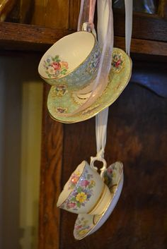 Do you have any tea cups that have chips in them but you don't have the heart to toss?  Super glue the saucers to them, add some ribbon and use them  as hanging decorations indoors or out.