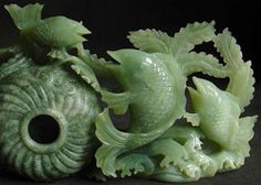 Here is a fine and beautiful jade carving. It is an artistic achievement in its compostition and a sculptural achievement for its negative space (the fish and plants are clearly spearated.) It makes a cood use of the natural material be carving the textured basket from the material that has a more speckled color.