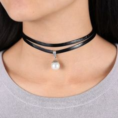 A single white pearl bead dangles from a two strand, black leatherette choker necklace. Soft, flexible and comfortable to wear. Pearl bead is removable and interchangeable. Choker measures 11 1/2 inch