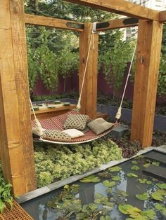 hammock bed - I wish I had a backyard that this would work in :-)