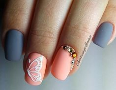Matte inspired butterfly nail art. The matte pastel colors n the nails look absolutely stunning and the protruding white butterfly outline also makes it look more elegant. The embellishments on top do a great job of accentuating the nails