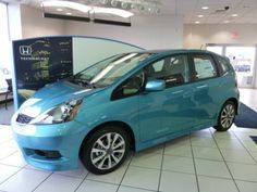 2012 Honda Fit Sport in Blue Raseberry..... I love this car :) Wouldn't mind having the navigation too... Lol
