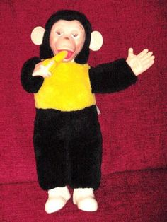 Rubber Faced Stuffed Toy Monkey/Chimp Holding a banana.