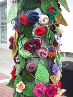 Knitted trees, leaves and flowers ~ What a neat way to cover up metal streetlight posts!