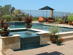 Special Features: Glass tile, travertine coping, raised spa with waterfall, shear decents, exposed aggregate decking, counter bar with stools, pebble tec, baja landing, Pentair Pool Products, controls, Sam lights, salt water