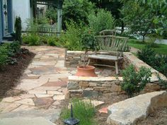Here is a front yard patio picture done in natural stone.
