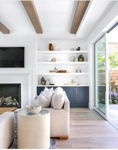 Clean and simple living room with built-in shelving